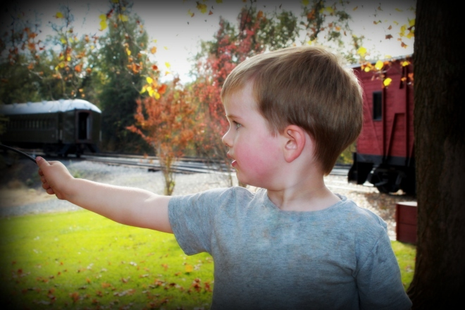 Soren pointing at the trains