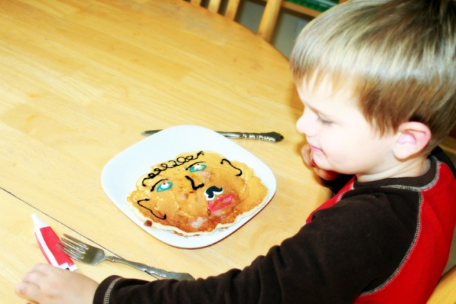 Soren's special pancake breakfast with frosting that looks like Grandpa Bruce