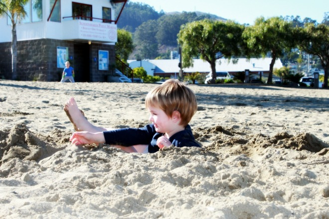 Up to his shoulders in sand, at Kayak Beach in Sausalito