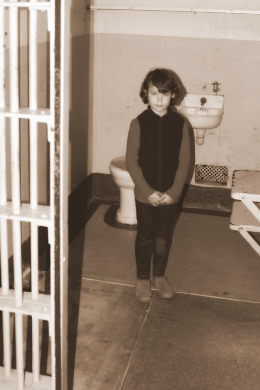 Claire in a cell in Alcatraz