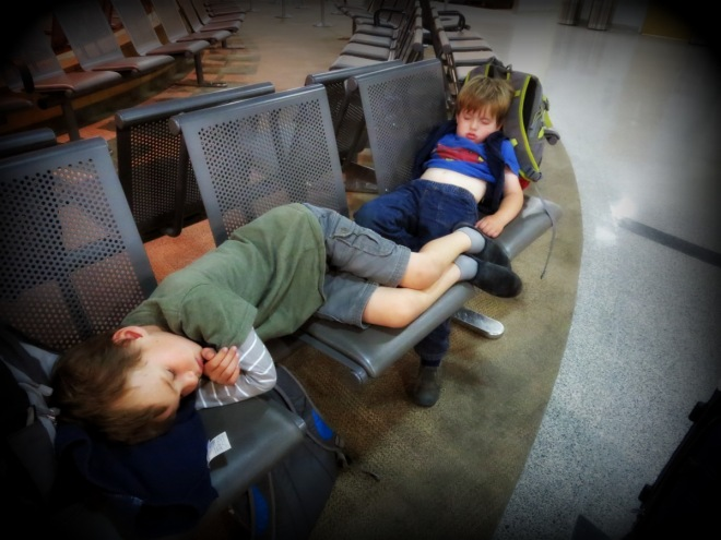 Sleepy children at the Sudbury Airport, waiting for transportation