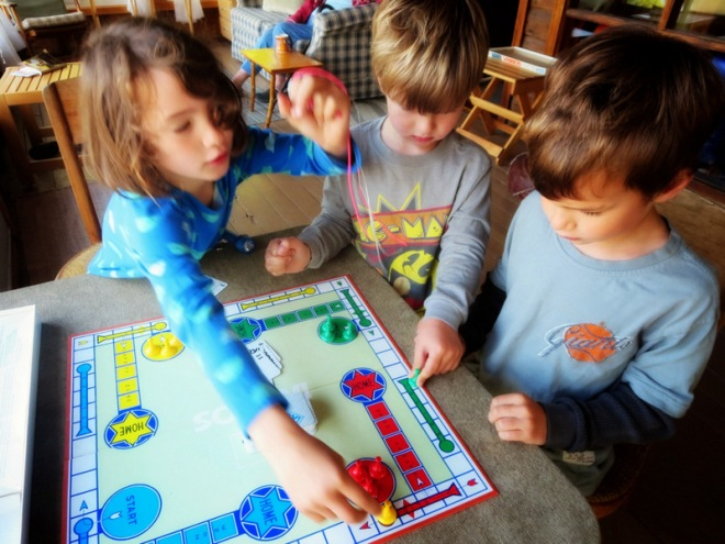 Three kids playing Sorry!