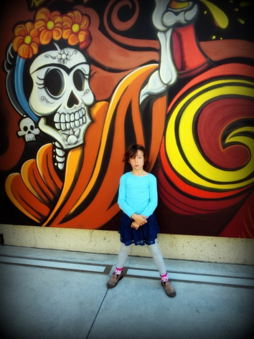 Claire in front of a Day of the Dead mural