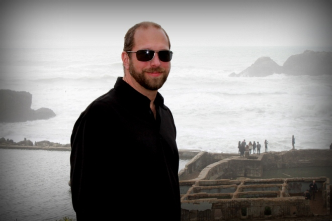Justin on the hill overlooking Sutro Baths