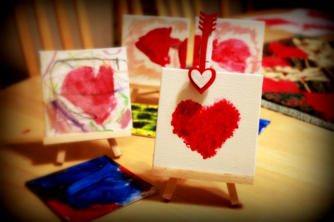 Mini canvases on mini easels.