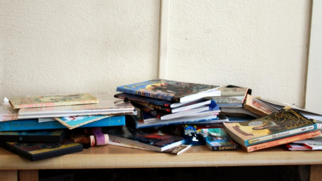Books from the past few days accumulated near the front door.