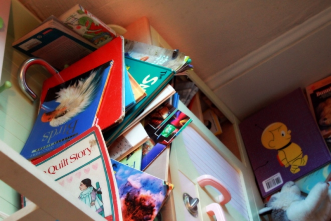 Play kitchen, totally taken over with books over the past few days
