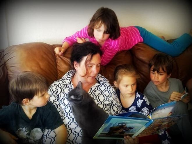 Me reading a new book to Soren, surrounded by kids