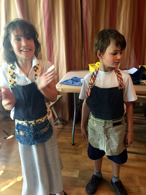 Claire and Ronin, with work aprons made from repurposed jeans