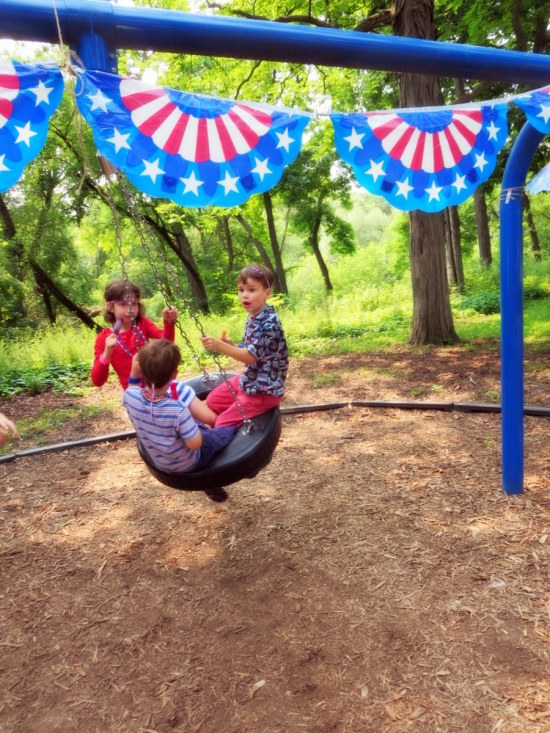 Claire: The 4th of July parade ended at the same park with the tire swing. There were popsicles and we ran races for prizes.