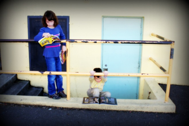 Claire and Ronin could not stop reading after they bought books at the school book fair
