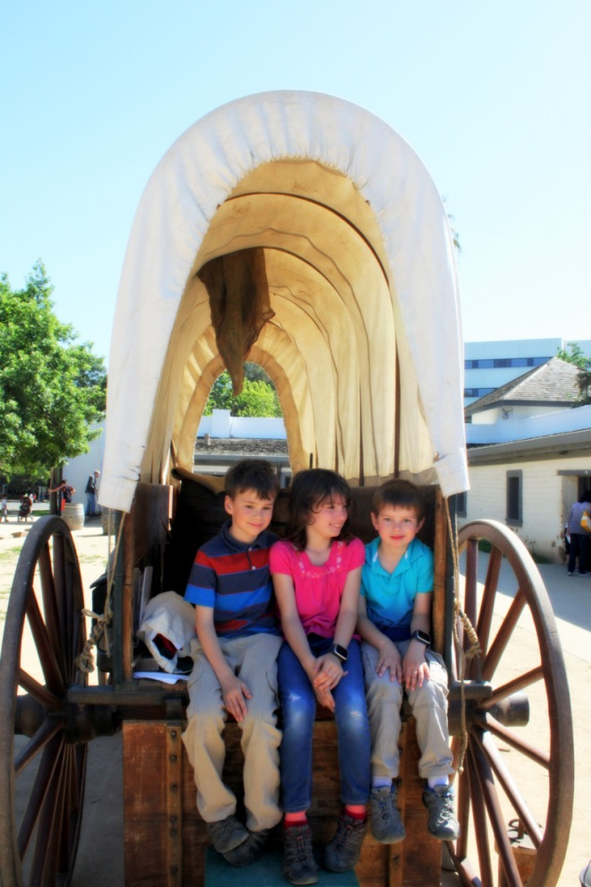 In a covered wagon at Sutter's Fort