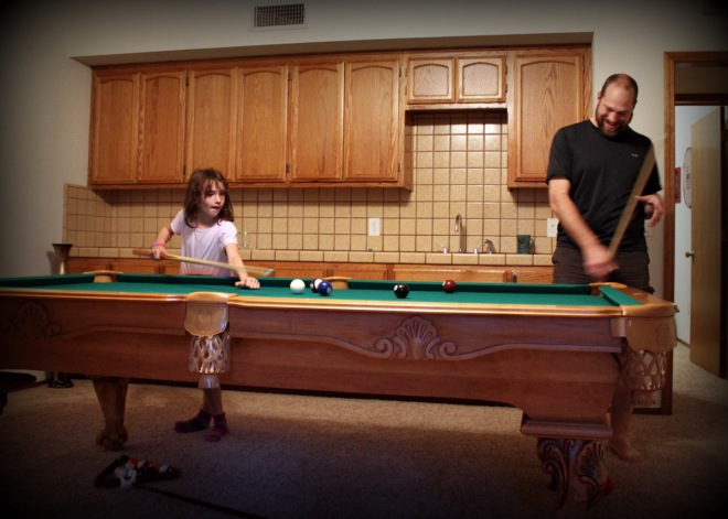 Claire and Justin playing pool