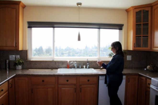 My mom admiring the view from the spacious kitchen