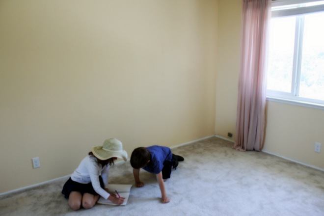 Claire and Soren drawing furniture layouts for a bedroom